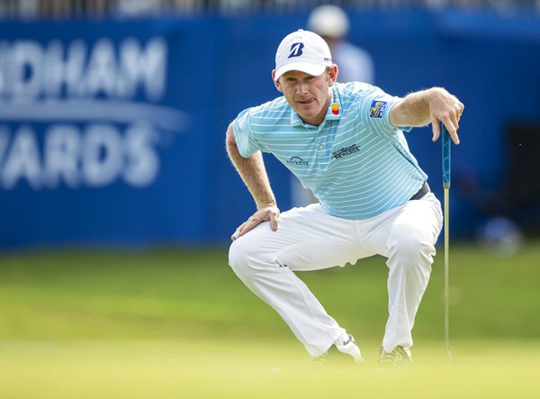 Brandt Snedeker lines up his putt on the 15th hole during the second round of the Wyndham Championship golf tournament at Sedgefield Country Club in Greensboro, N.C., Friday, Aug. 17. (Khadejeh Nikouyeh/News & Record via AP)