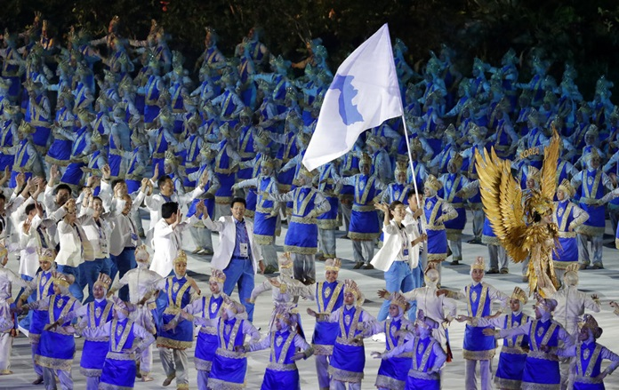 "The combined Koreas march into Gelora Bung Karno Stadium under the ""unification"" flag during the opening ceremony for the 18th Asian Games in Jakarta, Indonesia, Saturday, Aug. 18. (AP Photo/Lee Jin-man)"