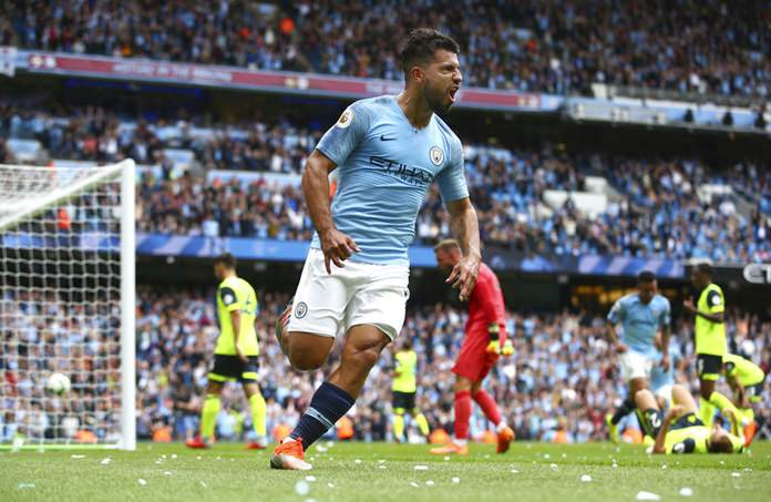Manchester City's Sergio Aguero celebrates scoring his side's third goal of the English Premier League soccer match between Manchester City and Huddersfield Town at the Etihad Stadium in Manchester, Sunday, Aug. 19. (AP Photo/Dave Thompson)