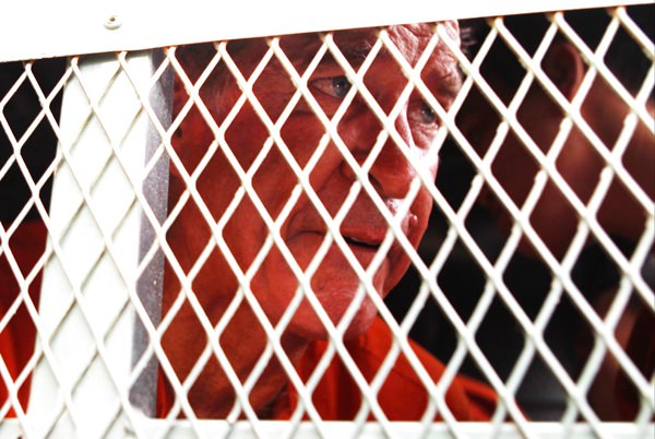 Australian filmmaker James Ricketson sits in a police truck upon his arrival at Phnom Penh Municipal Court in Phnom Penh, Cambodia, Monday, Aug. 20. (AP Photo/Heng Sinith)