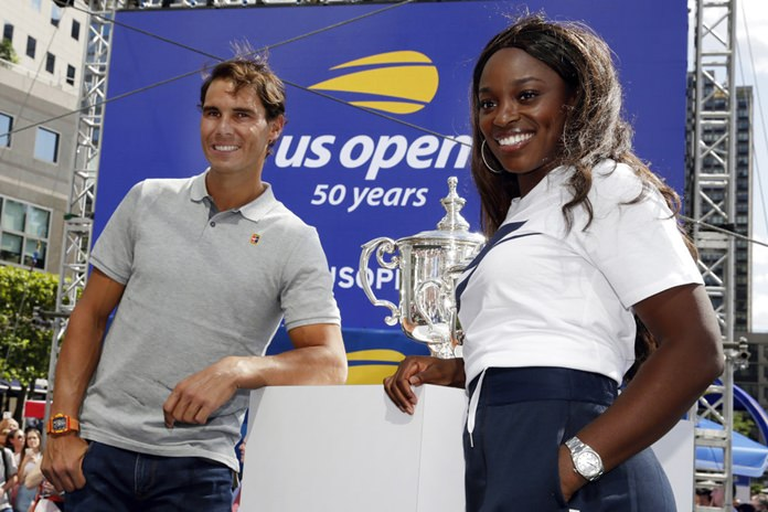 Defending champions Rafael Nadal and Sloane Stevens pose with the tournament's trophies during the reveal of the 2018 U.S. Open draw in New York, Thursday, Aug. 23. (AP Photo/Richard Drew)