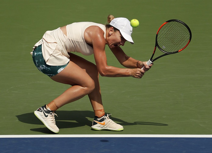 Simona Halep, of Romania, returns a shot to Kaia Kanepi, of Estonia, during the first round of the U.S. Open tennis tournament, Monday, Aug. 27, in New York. (AP Photo/Andres Kudacki)