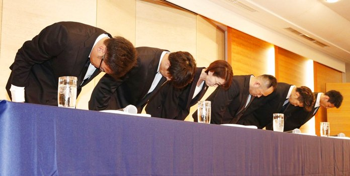 In this Aug. 20, 2018, photo, Yuya Nagayoshi, far left, Takuya Hashimoto, 2nd from left, Takuma Sato, 2nd from right, and Keita Imamura, far right, of Japanese men's basketball team for the Asian Games bow in apology at a press conference in Tokyo, after being stripped of their national team membership and sent back home in Jakarta. The four Japanese basketball players who hired prostitutes during the Asian Games in Indonesia have been suspended from play for one year. The head of the Japan Basketball Association announced the suspensions at a news conference in Tokyo on Wednesday, Aug. 29. (Kyodo News via AP)
