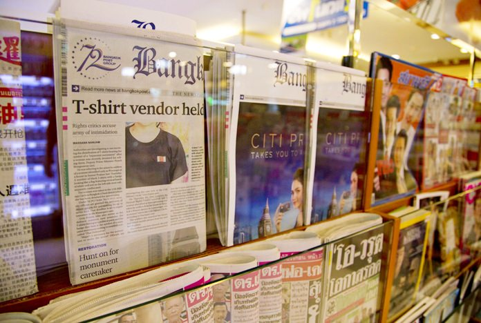 Thailand's Bangkok Post newspaper depicting a cover story on detention of a vender who sold black t-shirts, bearing a symbol allegedly linked to a movement promoting a federal republic, is displayed in a newspaper stall in Bangkok, Thailand, Tuesday, Sept. 11, 2018. (AP Photo/Gemunu Amarasinghe)