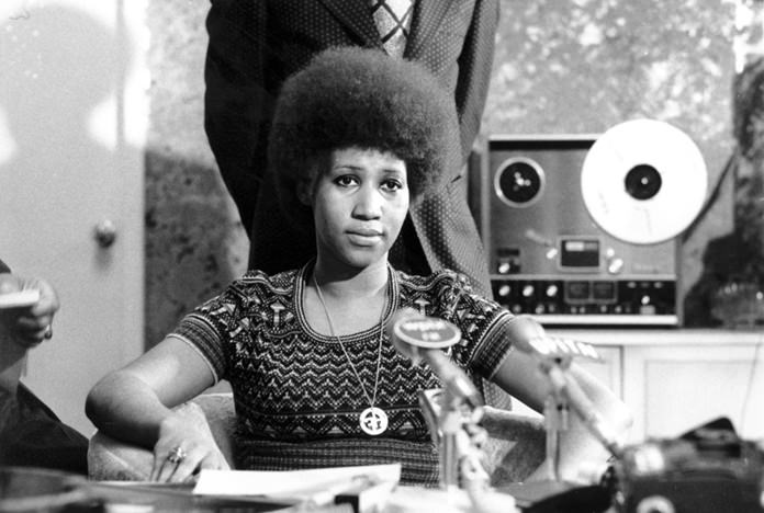 In this March 26, 1973 file photo, soul singer Aretha Franklin appears at a news conference. Franklin died Thursday, Aug. 16, 2018 at her home in Detroit. She was 76. Franklin and Sen. John McCain lived through the decade that reshaped so much of American life but were propelled into the 1970s and all the way to 2018, carrying some of the fundamental storylines of the 1960s as they hurtled forward. (AP Photo, File)