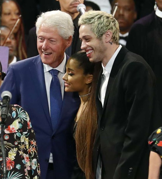 Former President Bill Clinton poses for a photo with Ariana Grande and Pete Davidson during Aretha Franklin's funeral. (AP Photo/Paul Sancya)