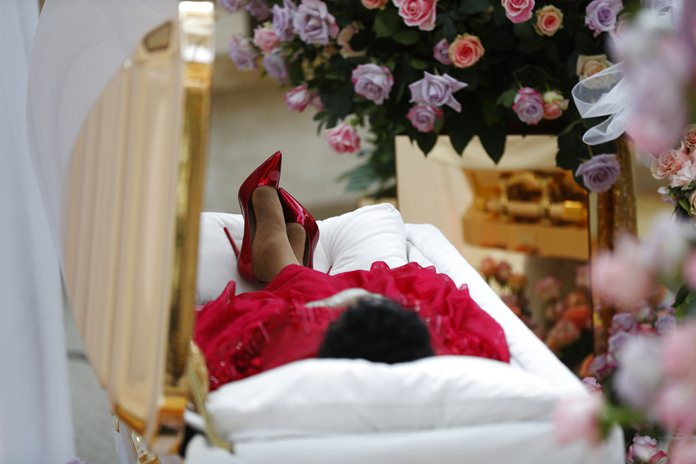 In this Aug. 28, 2018, file photo, Aretha Franklin lies in her casket at Charles H. Wright Museum of African American History during a public visitation in Detroit. (AP Photo/Paul Sancya, Pool)