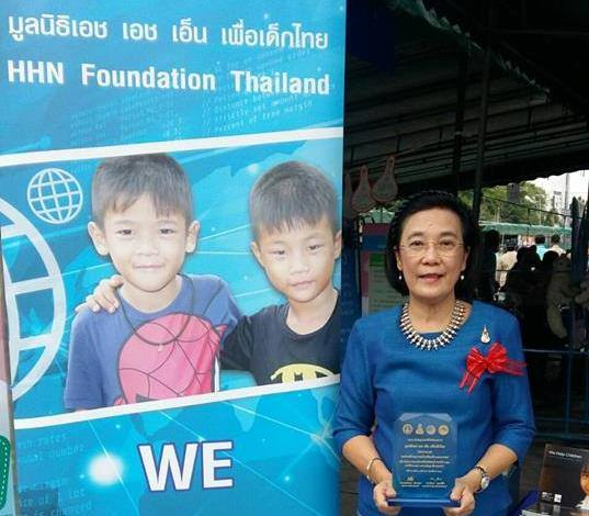 HHN Director Radchada Chomjinda on behalf of the Human Help Network Thailand accepts the award for their children's charity work with orphans, children and youths.