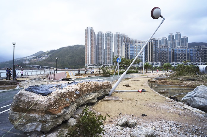 Hong Kong and southern China hunkered down as strong winds and heavy rain from Typhoon Mangkhut lashed the densely populated coast. The biggest storm of the year left dozens dead from landslides and drownings as it sliced through the northern Philippines. (AP Photo/Vincent Yu)
