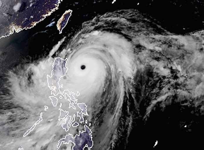 A satellite image with land graphic borders shows the width and trajectory of Typhoon Mangkhut as it approaches the Philippines, Friday, Sept. 14. (RAMMB and CIRA via AP, File)