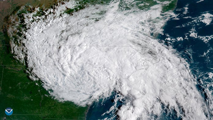 This satellite image provided by NOAA shows Tropical Depression Florence moving west across the United States on Sunday, Sept. 16. (NOAA via AP)