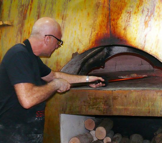 Sergio supervising the wood firing.