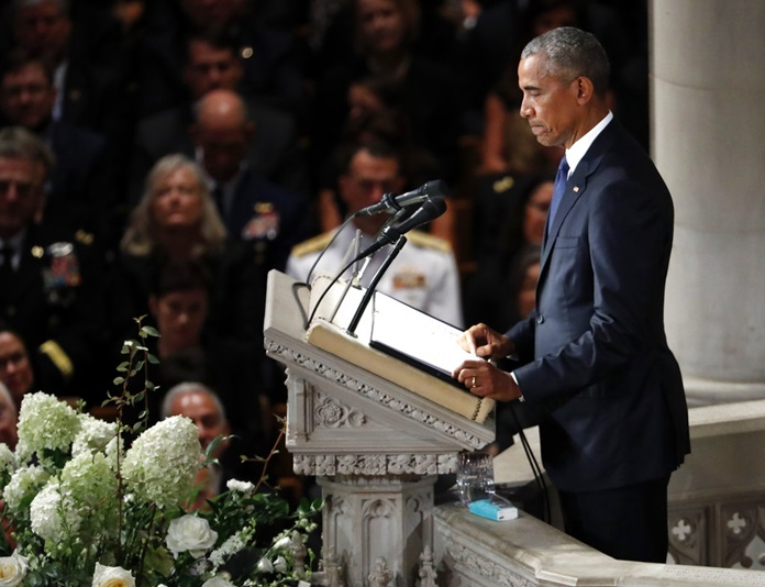 Former President Barack Obama pauses as he speaks at a memorial service for Sen. John McCain, R-Ariz., at Washington National Cathedral in Washington, Saturday, Sept. 1, 2018. (AP Photo/Pablo Martinez Monsivais)