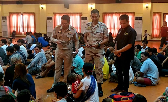 In this Aug. 28, 2018, photo, Thai officers talks to refugee and asylum seekers in Bangkok, Thailand. Thai police rounded up more than 160 refugees and asylum seekers from ethnic minorities in Vietnam and Cambodia who are believed to be at risk of persecution if they are returned to their homelands. (AP Photo