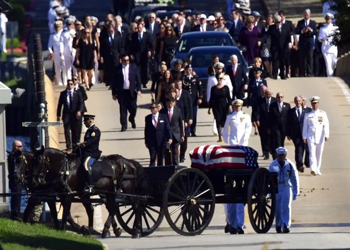 Family members, including Cindy McCain, back center, follow a horse-drawn caisson that carries the casket of Sen. John McCain, R-Ariz., as it proceeds to the United States Naval Academy cemetery in Annapolis, Md., Sunday, Sept. 2, 2018, for burial. (AP Photo/Susan Walsh)