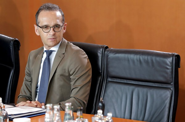 """FILE - In this May 30, 2018 file photo German Foreign Minister Heiko Maas attends the weekly cabinet meeting at the Chancellery in Berlin. Germany's foreign minister tells his fellow countrymen they're too lazy when it comes to battling racism and fighting for democracy. Heiko Maas, 51, said Sunday, """"We have to get up from the couch and open the mouth."""" (AP Photo/Michael Sohn, file)"""
