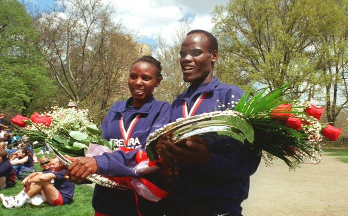 In this Saturday, April 26, 1997 file photo, Sally Barsosio and Paul Koech, right, both from Kenya, celebrate winning the Trevira Twosome 10K run in New York's Central Park. Former world half marathon champion Paul Koech of Kenya died on on Monday Sept. 3, 2018, but no cause of death was given. He was 49. (AP Photo/Gino Domenico, File)