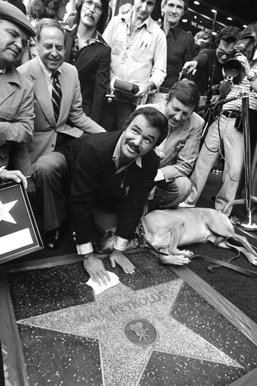 In this March 15, 1978 file photo, actor Burt Reynolds polishes star that was unveiled in the Hollywood Walk of Fame in Los Angeles. (AP Photo/file)