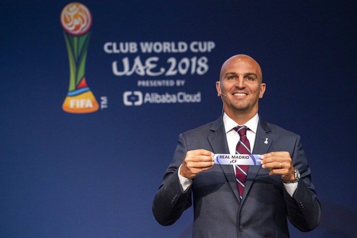 Former Argentine footballer Esteban Cambiasso displays the name of Real Madrid during the Official Draw for the FIFA Club World Cup UAE 2018 on Tuesday, September 4, 2018, at the FIFA headquarters in Zurich, Switzerland. (Ennio Leanza/Keystone via AP)