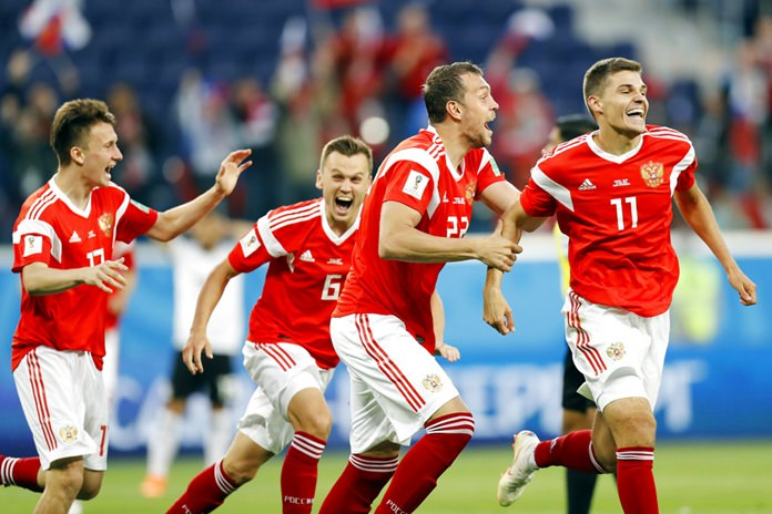 In this Tuesday, June 19, 2018 file photo, from left, Russia's Alexander Golovin, Denis Cheryshev, Artyom Dzyuba, and Roman Zobnin celebrate the first goal of the group A match between Russia and Egypt at the 2018 soccer World Cup in the St. Petersburg stadium in St. Petersburg, Russia. (AP Photo/Efrem Lukatsky, file)