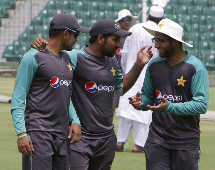 Sarafraz Ahmed, center, captain of Pakistani cricket team briefs players during the team practice session in Lahore, Pakistan, Tuesday, Sept. 4, 2018. Ehsan Mani was officially elected unopposed as the chairman of Pakistan Cricket Board on Tuesday. Prime minister Imran Khan, who is also patron of the PCB, nominated Mani as the member of the Board of Governors last month after Najam Sethi resigned as the PCB chairman. (AP Photo/K.M. Chaudary)