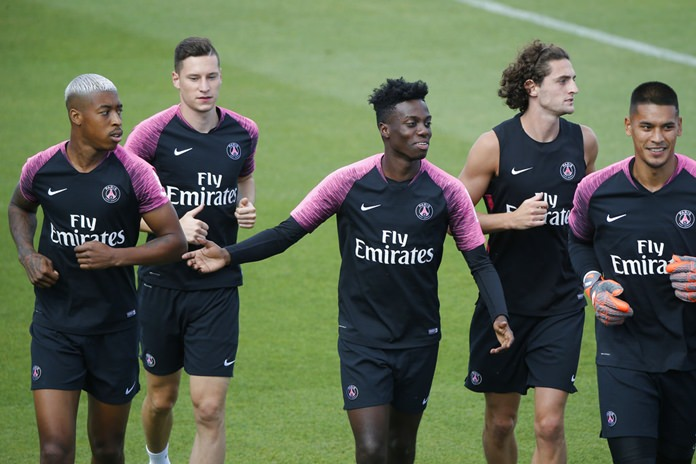 In this Aug. 17, 2018, file photo, Paris Saint-Germain's Timothy Weah, center, runs with teammates during a training session at the club's training center in Saint Germain en Laye, France. Weah, the 18-year-old son of former FIFA Player of the Year and current Liberia President George Weah, says he turned down a possible loan to remain and learn this season at Paris Saint-Germain, where he just scored his first Ligue 1 goal. (AP Photo/Michel Euler, File)