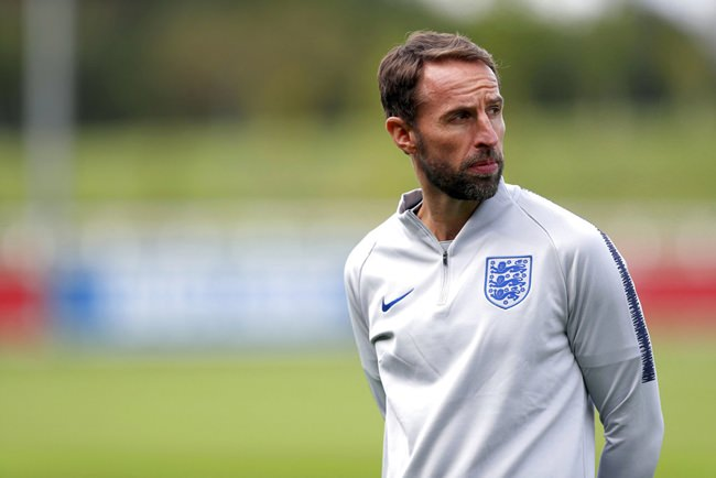 England manager Gareth Southgate attends a training session at St Georges' Park, Burton, England, Friday, Sept. 7, 2018. The England squad has gathered ahead of international matches against Spain and Switzerland and it's a chance for players to reminisce about their journey to the World Cup semifinals in a summer when the English fell back in love with their national soccer team. (David Davies/PA via AP)