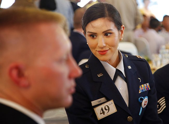 """U.S. Air Force Cpt. Jessica Tait, the spokesperson for the U.S. military team that assisted in the cave rescue operation, smiles during the event titled the """"United as One"""" in Bangkok, Thailand, Thursday, Sept. 6, 2018. (AP Photo/Sakchai Lalit)"""