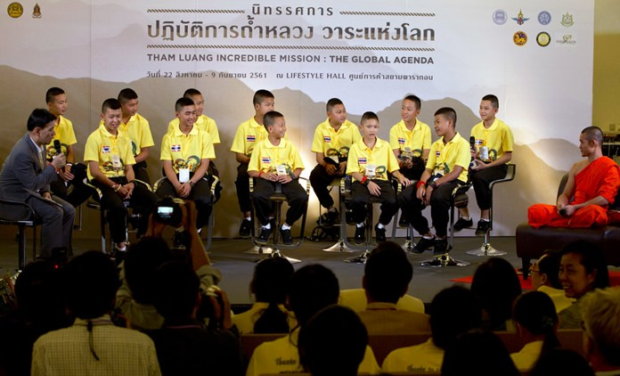 Members of the Wild Boars soccer team attend a public discussion in Bangkok, Thailand, Thursday, Sept. 6, 2018. They spoke Thursday at an exhibition about their ordeal of being trapped for almost three weeks in a flooded cave, at one of Bangkok's largest shopping malls. (AP Photo/Gemunu Amarasinghe)