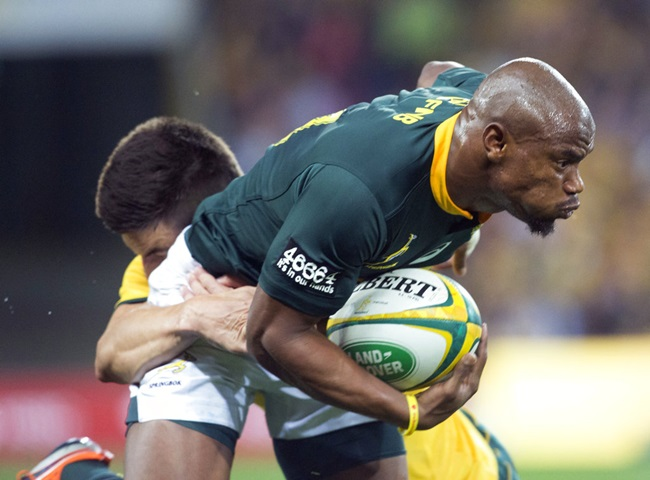 Australia's Jack Maddocks, rear, tackles South Africa's Makazole Mapimpi during their rugby union test match in Brisbane, Australia, Saturday, Sept. 8, 2018. (AP Photo/Dave Kapernick)