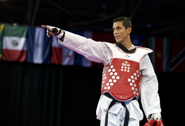 In this July 21, 2015 file photo, United States' Steven Lopez celebrates winning a bronze medal by defeating Venezuela's Javier Medina in the men's taekwondo under-80kg category at the Pan Am Games in Mississauga, Ontario. The U.S. Center for SafeSport has on Thursday, Sept. 6, 2018, permanently banned the two-time Olympic taekwondo champion for sexual misconduct involving a minor. (AP Photo/Rebecca Blackwell, File)