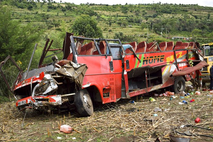 The wrecked bus is seen at the scene of the crash near Kericho in western Kenya Wednesday, Oct. 10. (AP Photo/Washington Sigu)