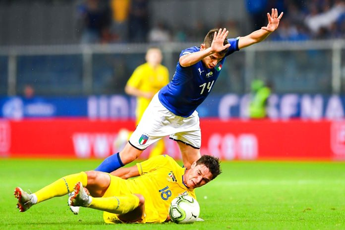 Italy's Jorginho, top, and Ukrainian Roman Yaremchuk vie for the ball, during the international friendly soccer match between Italy and Ukraine, at the Luigi Ferraris stadium in Genoa, Italy, Wednesday, Oct. 10. (Simone Arveda/ANSA via AP)