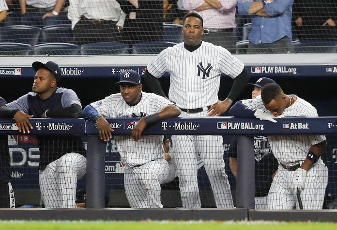 The New York Yankees watch from the dugout during the ninth inning of Game 4 of baseball's American League Division Series against the Boston Red Sox, Tuesday, Oct. 9, in New York. (AP Photo/Julie Jacobson)