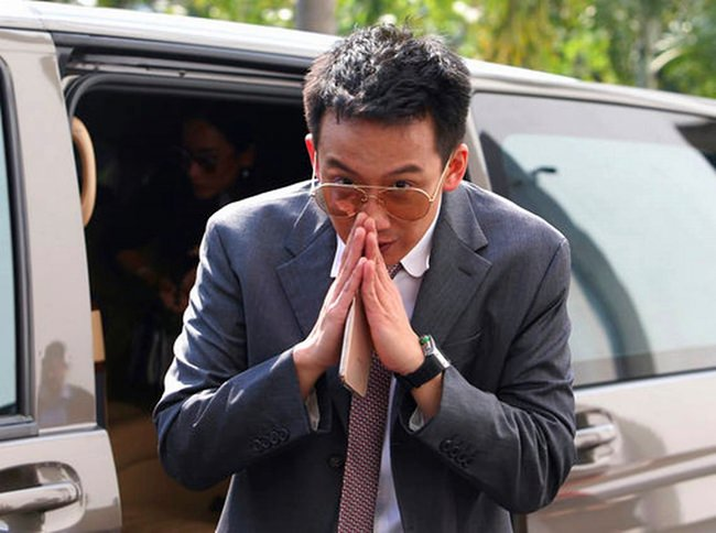 Phantongtae Shinawatra, son of ousted Prime Minister Thaksin Shinawatra, arrives at prosecutor's office Bangkok, Wednesday, Oct. 10. (AP Photo)