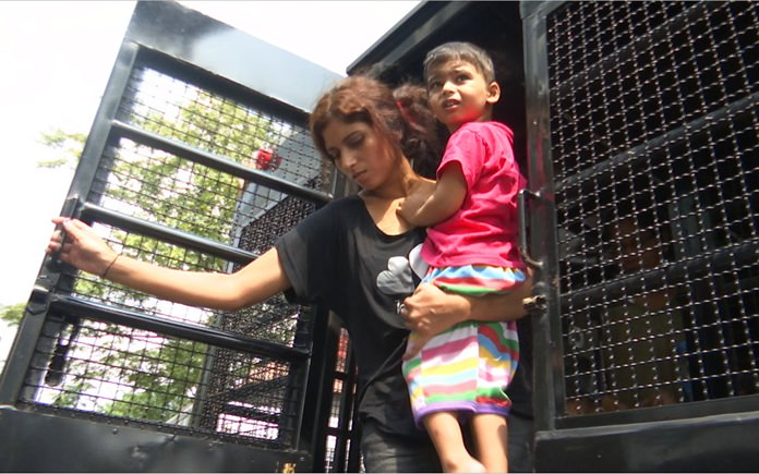 Pakistani refugees exit a police truck as they arrive at the Immigration Detention Center, Thursday, Oct. 11, in Bangkok. (AP Photo/Tassanee Vejpongsa)