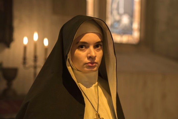 """This image released by Warner Bros. Pictures shows Ingrid Bisu in a scene from """"The Nun."""" (Justin Lubin/Warner Bros. Pictures via AP)"""