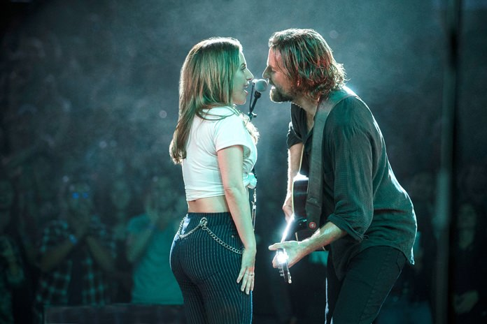 """This image shows Lady Gaga (left) and Bradley Cooper in a scene from """"A Star is Born."""" (Clay Enos/Warner Bros. Pictures via AP)"""