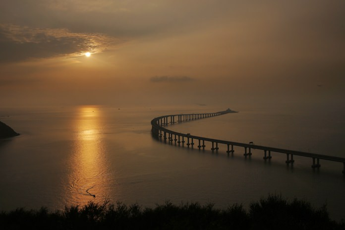 The Hong Kong-Zhuhai-Macau Bridge is seen against the sunset in Hong Kong. (AP Photo/Kin Cheung)