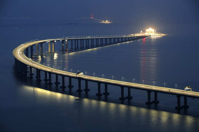 The Hong Kong-Zhuhai-Macau Bridge is lit up in Hong Kong, Monday, Oct. 22. (AP Photo/Kin Cheung)