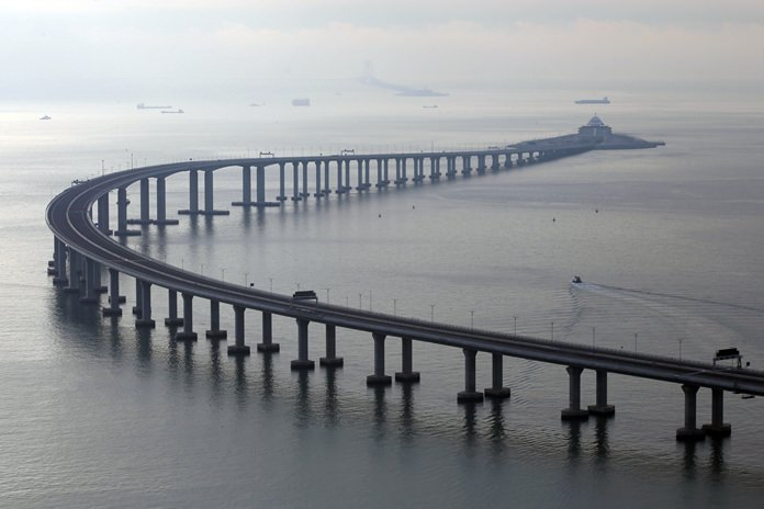 The 55-kilometer (34-mile)-long bridge includes an undersea tunnel allowing ships to pass through the Pearl River delta, the heart of China's crucial manufacturing sector. (AP Photo/Kin Cheung)