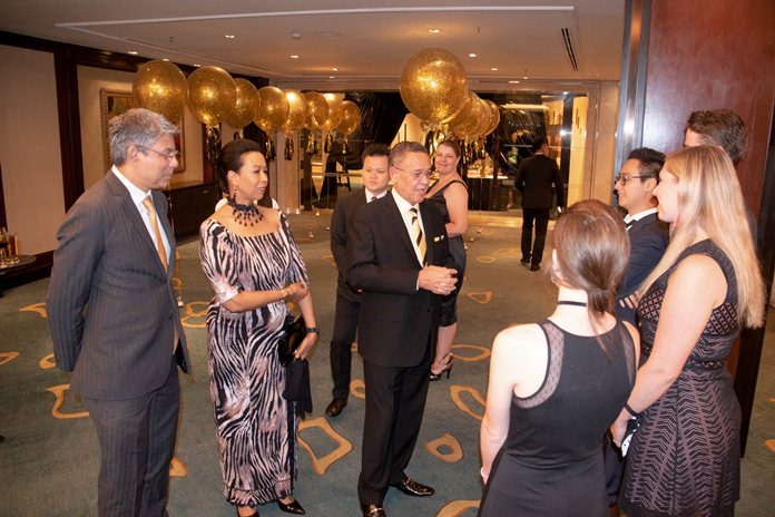 H.E. Geoff Doidge and Madame Carol greet the guests. At left is Ragil Ratnam, the Chairman of the South Africa Thailand Chamber of Commerce.