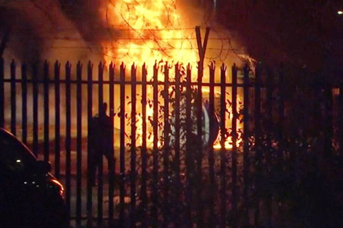 This image made from video shows a burning helicopter in a parking lot outside the King Power Stadium in Leicester, England shortly after a Premier League game on Saturday, Oct. 27, 2018. (Pool Photo via AP)