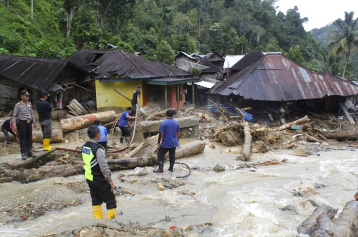 Rescuers search for victims following a flash flood in Mandailing Natal district, North Sumatra, Indonesia, Saturday, Oct. 13. (AP Photo/Khairul Bazar)