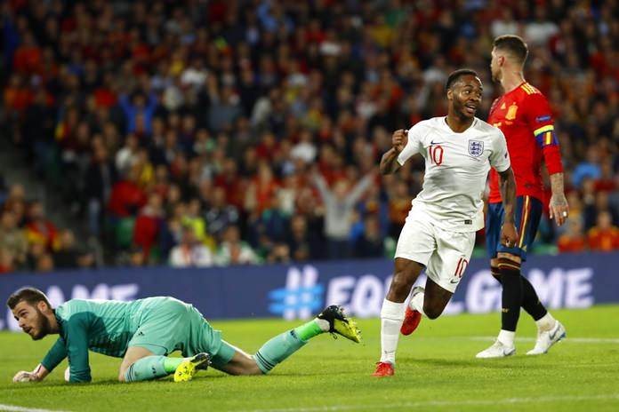 England's Raheem Sterling, left, celebrates after scoring his side's third goal during the UEFA Nations League soccer match between Spain and England at Benito Villamarin stadium, in Seville, Spain, Monday, Oct. 15. (AP Photo/Miguel Morenatti)