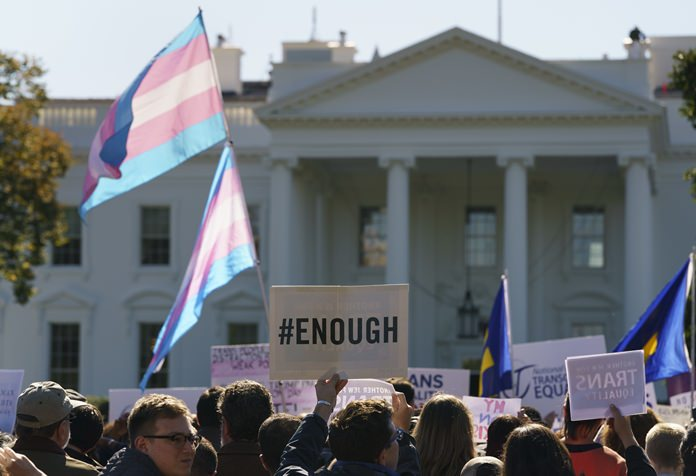"""The National Center for Transgender Equality, NCTE, and the Human Rights Campaign gather on Pennsylvania Avenue in front of the White House in Washington, Monday, Oct. 22, 2018, for a #WontBeErased rally. Anatomy at birth may prompt a check in the """"male"""" or """"female"""" box on the birth certificate - but to doctors and scientists, sex and gender aren't always the same thing. (AP Photo/Carolyn Kaster)"""
