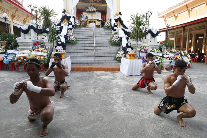Thai boxers perform their traditional dance showing respect at the coffin of 13-year-old Thai kickboxer Anucha Tasako during his funeral services. (AP Photo/Sakchai Lalit)