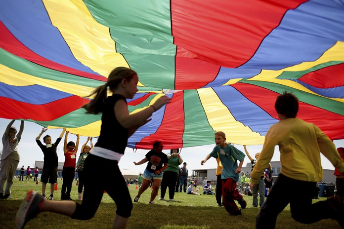 New federal guidelines released on Monday, Nov. 12, 2018, advise that children as young as age 3 should move more, sit less and get more active, and that any amount and any type of exercise helps health. (Aaron Marineau/The Hutchinson News via AP)