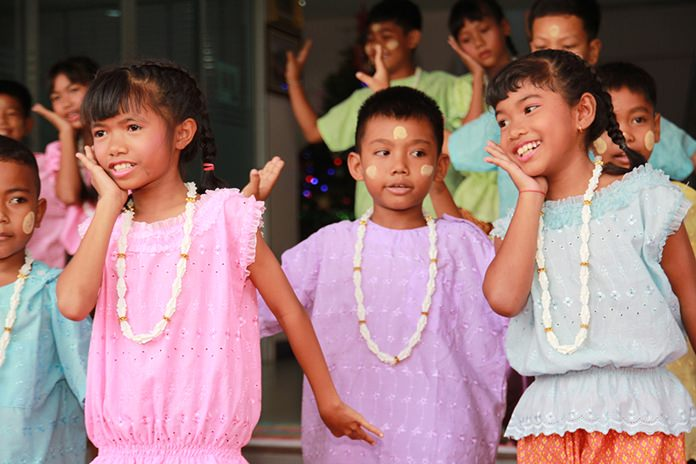 The children perform a lovely traditional dance for the honored guests.