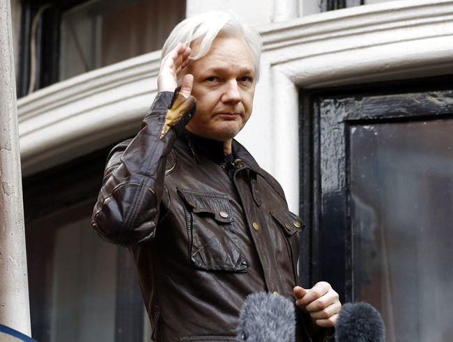 In this May 19, 2017, file photo, WikiLeaks founder Julian Assange greets supporters from a balcony of the Ecuadorian embassy in London. (AP Photo/Frank Augstein)